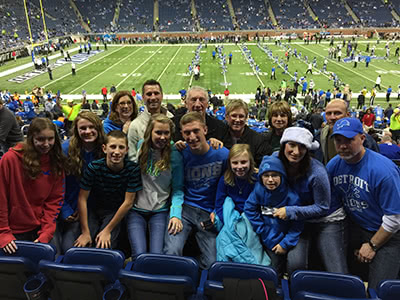 Jeremy Peruski and family at a Lions game