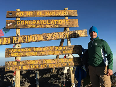 Jeremy Peruski on Mt. Kilimanjaro summit