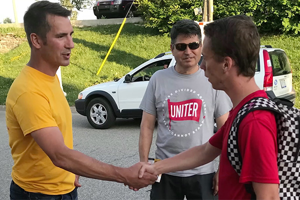 Jeremy Peruski shaking hands